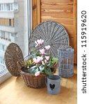 Pink cyclamen flowers in basket on a window - stock photo