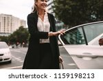smiling woman commuter getting... | Shutterstock . vector #1159198213