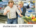 young playful husband fooling... | Shutterstock . vector #1159200709