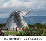 Small photo of Falkirk, United Kingdom - August 09 2018: Tourists around the Kelpies - a pair of large horse head statues made from Stainless steel by Sculptor Andy Scott and unveiled in 2013