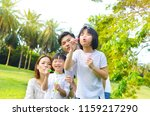 asian family blowing bubbles in ... | Shutterstock . vector #1159217290