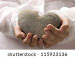 little girl holding heart...   Shutterstock . vector #115923136