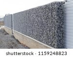 newly build gabions fence | Shutterstock . vector #1159248823