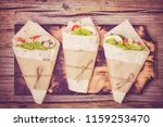 mexican wraps wrapped tortilla... | Shutterstock . vector #1159253470