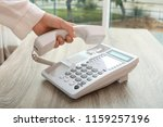 woman using telephone at table... | Shutterstock . vector #1159257196