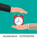 hand with red alarm clock.... | Shutterstock . vector #1159263106
