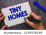 writing note showing tiny homes.... | Shutterstock . vector #1159278190