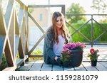 pretty young female gardening... | Shutterstock . vector #1159281079