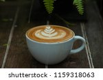 a cup of hot latte coffee cup | Shutterstock . vector #1159318063