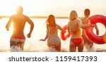 rearview of a group of young... | Shutterstock . vector #1159417393