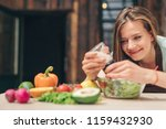 smiling girl cooking in the... | Shutterstock . vector #1159432930