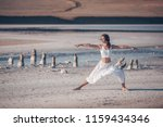 young girl practicing yoga... | Shutterstock . vector #1159434346