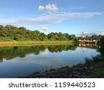reflection in river waterway ... | Shutterstock . vector #1159440523