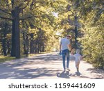 young family with a skateboard... | Shutterstock . vector #1159441609