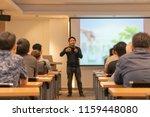 asian speaker is speaking on... | Shutterstock . vector #1159448080