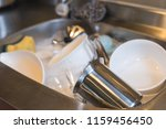 dirty dishes in the kitchen... | Shutterstock . vector #1159456450