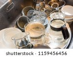 dirty dishes in the kitchen... | Shutterstock . vector #1159456456
