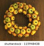 Autumn pumpkins decoration on wooden door - stock photo