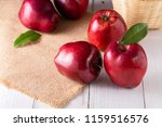 red apples with leaves on the... | Shutterstock . vector #1159516576