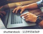 man using laptop  searching web ... | Shutterstock . vector #1159556569