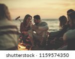 group of young friends sitting... | Shutterstock . vector #1159574350