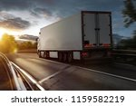 truck drives on a highway | Shutterstock . vector #1159582219