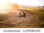the racer on a motorcycle... | Shutterstock . vector #1159584190