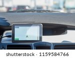 a car with a navigator is... | Shutterstock . vector #1159584766