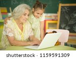 portrait of a grandmother and... | Shutterstock . vector #1159591309