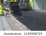Asphalt Is Unloaded From A...