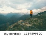man traveler hiking in... | Shutterstock . vector #1159599520