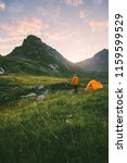 camping in mountains man alone... | Shutterstock . vector #1159599529