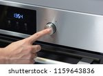 the girl sets the temperature... | Shutterstock . vector #1159643836