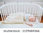 adorable baby girl sleeping in...   Shutterstock . vector #1159684366