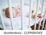 adorable baby girl sleeping in... | Shutterstock . vector #1159684369
