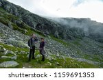 young couple in holiday hiking... | Shutterstock . vector #1159691353