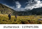 young couple in holiday hiking... | Shutterstock . vector #1159691386