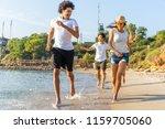 group of friends run through... | Shutterstock . vector #1159705060