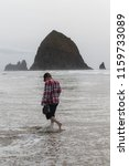 exploring cannon beach on the... | Shutterstock . vector #1159733089