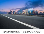 highway pavement and skyline of ... | Shutterstock . vector #1159737739