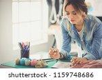 fashion designer woman working...   Shutterstock . vector #1159748686