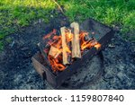 flame of wood burning in... | Shutterstock . vector #1159807840
