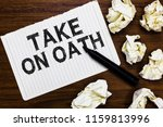 Small photo of Text sign showing Take On Oath. Conceptual photo A solemn appeal to a deity Speak the truth Make a Promise Marker over notebook crumpled papers ripped pages several tries mistakes.