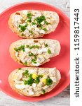 slice of crusty baguette with... | Shutterstock . vector #1159817443