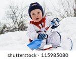 Kid Holding A Shovel Against...
