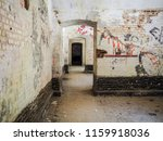 Old Rooms With Graffiti In...