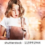 Happy Little Girl Opening a Present - stock photo