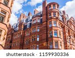 Small photo of Opulent British Victorian terraced luxury residential building in red bricks in Mayfair, London, UK