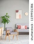 wooden armchair in pink and...