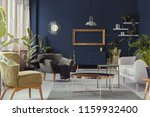 copper table between armchairs... | Shutterstock . vector #1159932400
